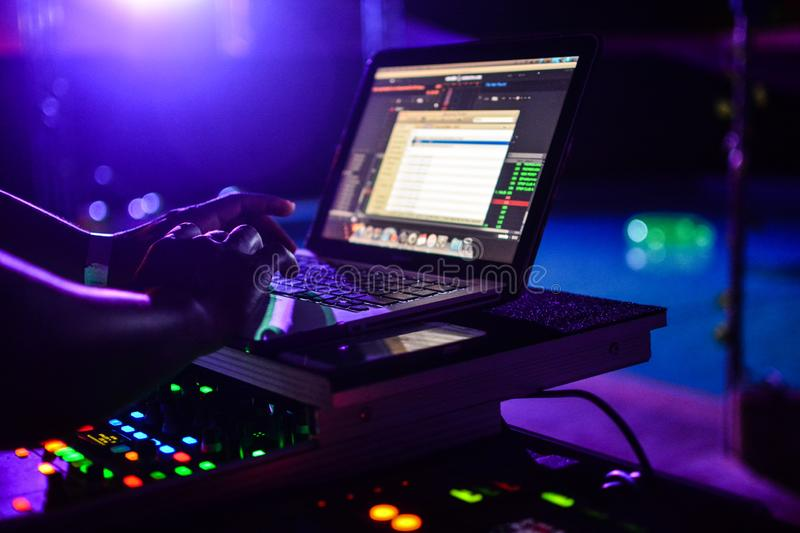 DJ Console and laptop lights at party stock photo