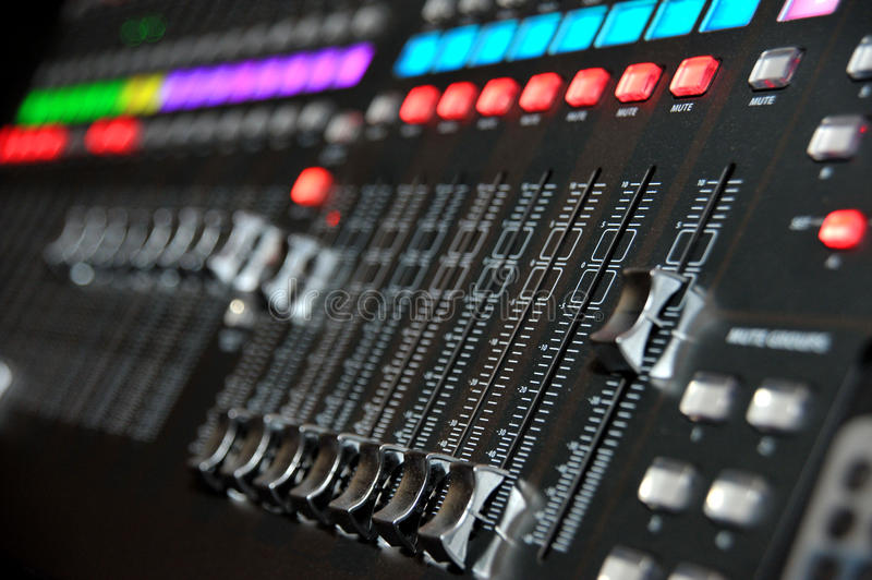DJ console. With sliders stock images