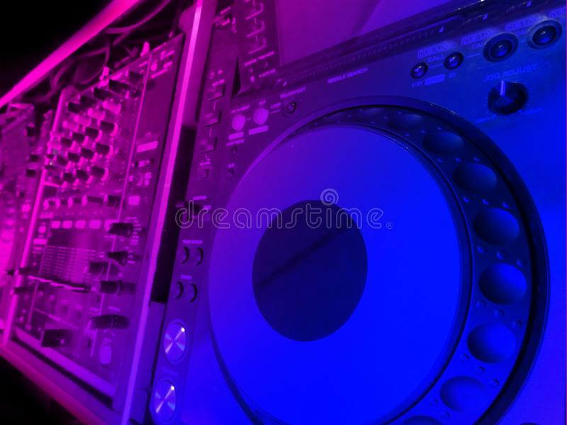 DJ control to mix music with blurred background stock images