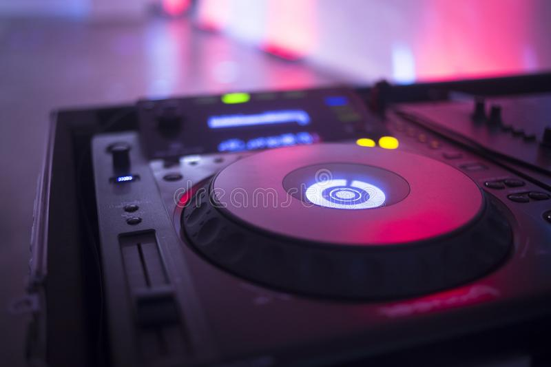 DJ deejay in wedding party. DJ deejay mixing desk equipment in wedding receoption party disco with color discotheque lights royalty free stock image
