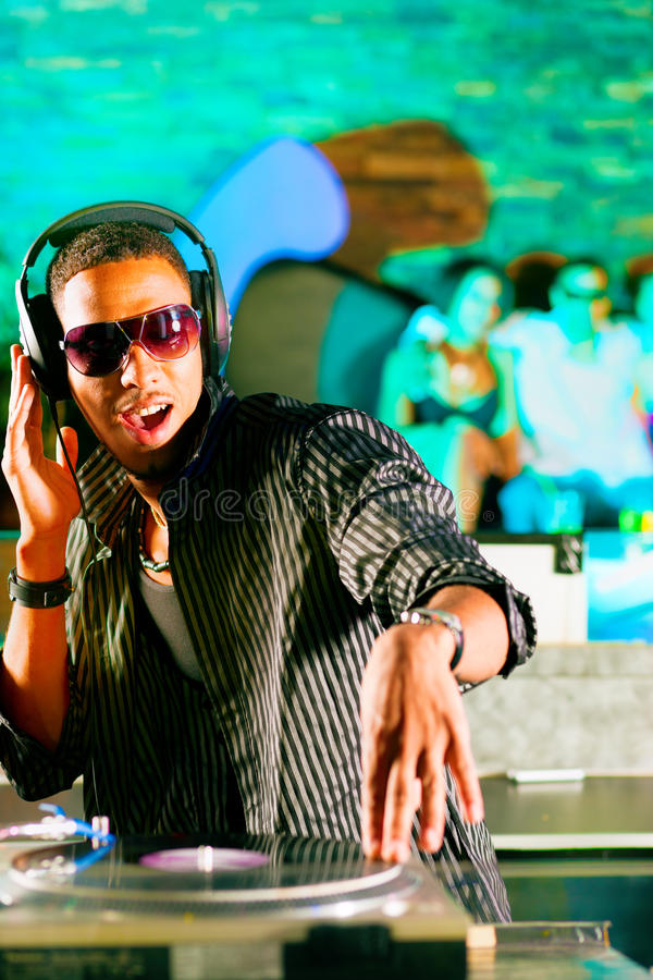 DJ in disco club, crowd background royalty free stock images