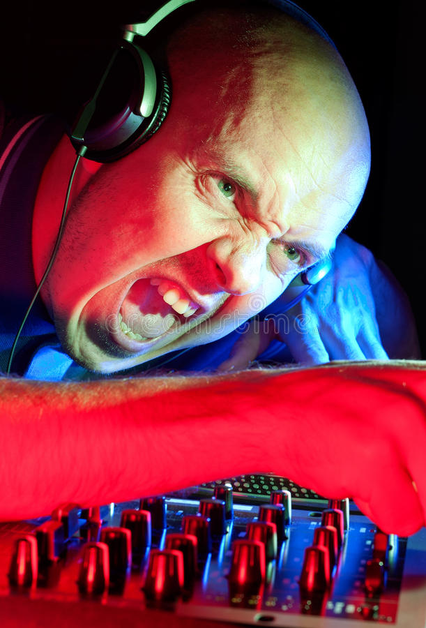 DJ going wild getting the crowd going stock images