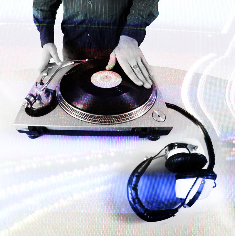 Dj hand. Shot of hand of male dj scratching turntables stock photos