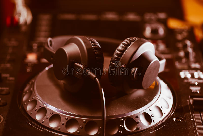 DJ headphones on CD music player stock photo