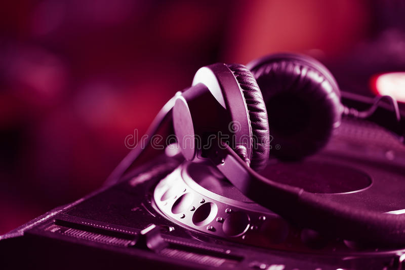 DJ headphones on CD music player royalty free stock images