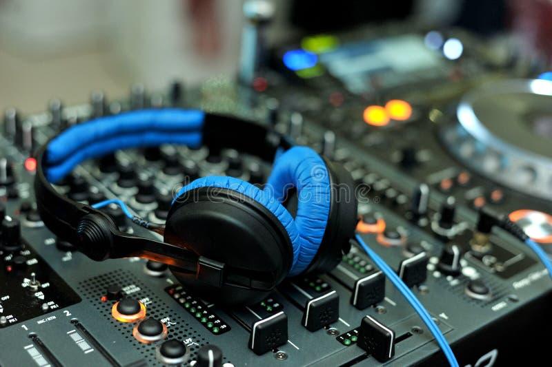 DJ Headphones on console. Blue and black headphones on DJ console stock photo
