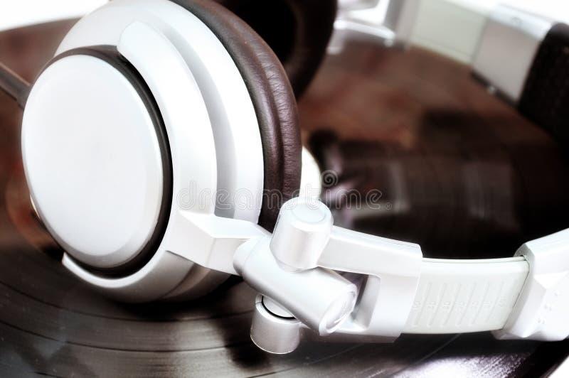DJ Headphones Lying Over Old Vinyl Stock Photos