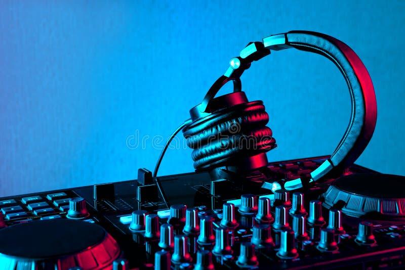 Dj headphones and mixer royalty free stock photography