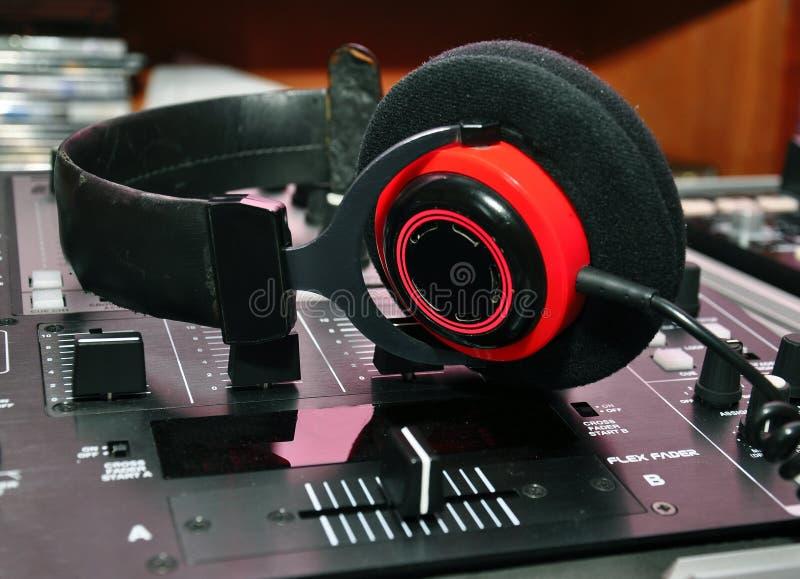 DJ headphones and mixer. Professional audio equipment for a DJ - headphones and mixer royalty free stock photo