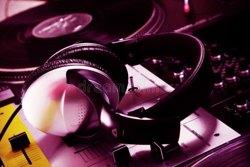 DJ headphones on sound mixer stock image