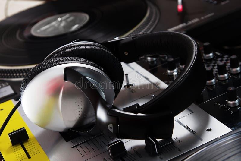 DJ headphones on sound mixer stock photos