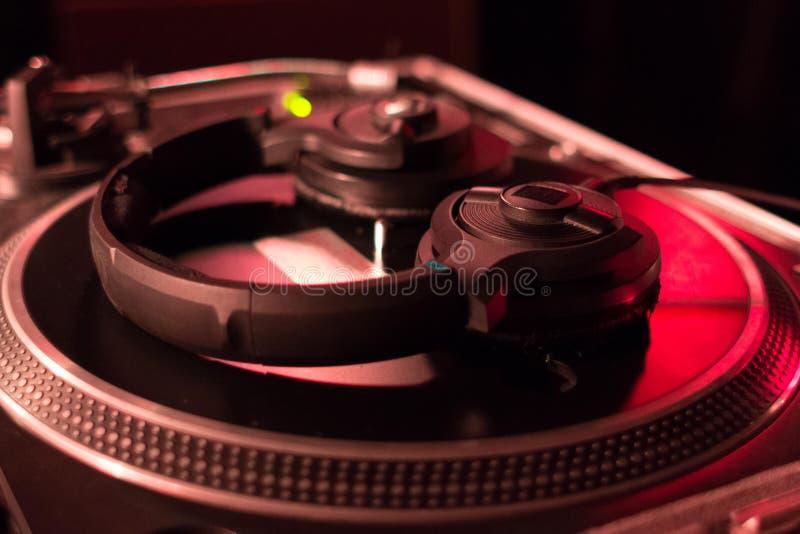 DJ headphones on vinyl player stock image
