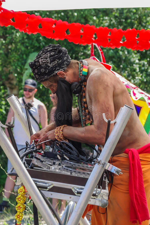 DJ and his console. DJ disguised as an Indian, connecting cables to the console