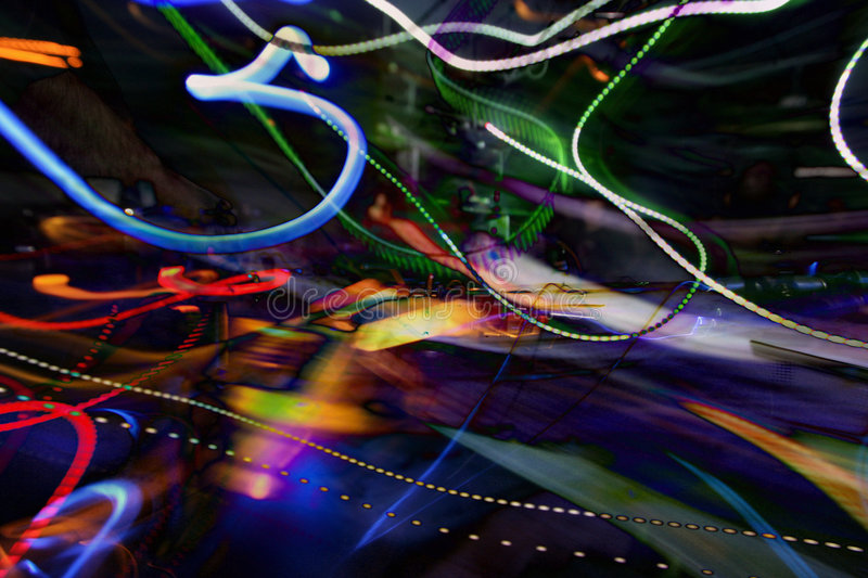 Dj and lights abstract. Dj mixing at a club, with abstract trails of light