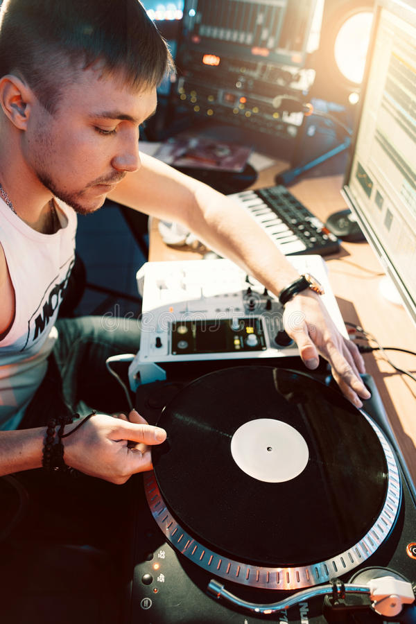 DJ making music in the recording studio stock images