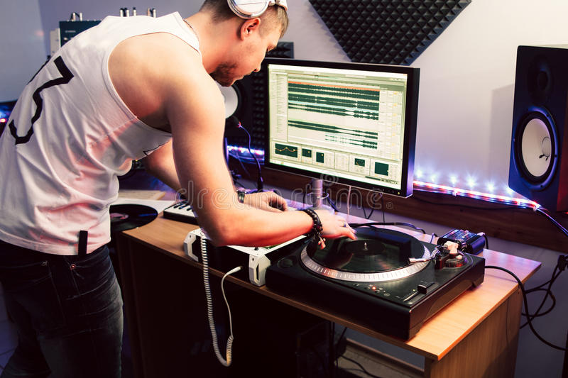 DJ making music in sound recording studio royalty free stock photography