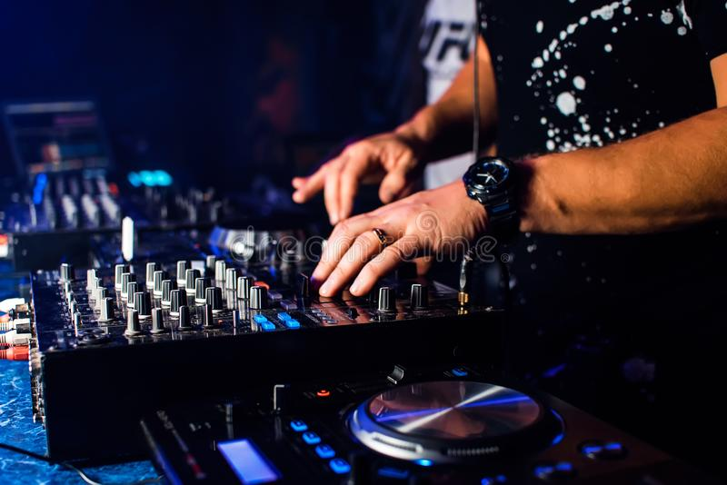 DJ mix music in a professional music boards and equipment. DJ mix music in professional music boards and equipment for mixing music in nightclub stock photo