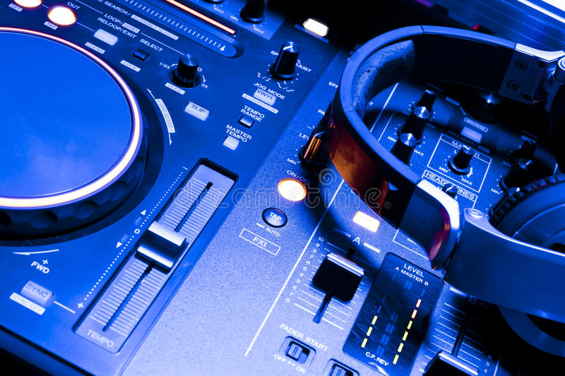 Dj mixer console and headphones. A view of DJ headphones Pioneer on the Pioneer audio console in the club stock photos