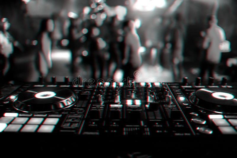 DJ mixer controller Board for mixing music in a nightclub. At a party. Black and white photo with glitch effect and small grain stock photo