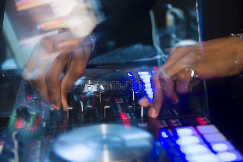 Dj mixer with dj hands make music royalty free stock photo
