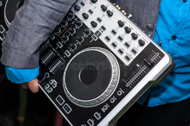 Dj mixer equipment. Man holding a Dj mixer equipment stock photography