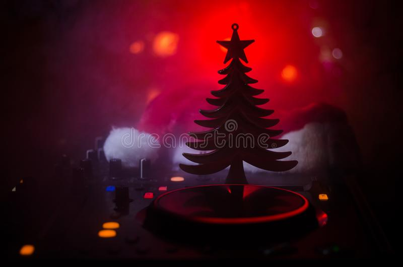 Download Dj Mixer With Headphones On Dark Nightclub Background With Christmas Tree New Year Eve. Close Up View Of New Year Elements Or Symb Stock Image - Image of disc, hearts: 106697907
