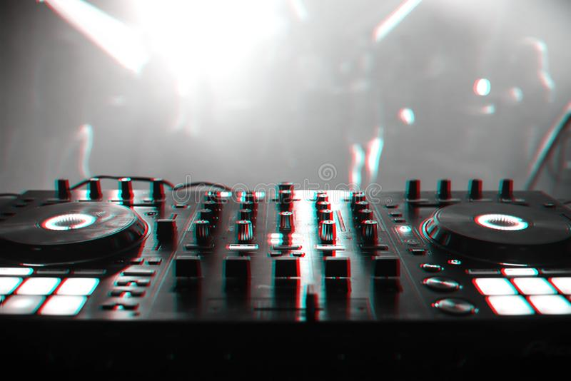 DJ mixer for mixing music and sound. In a nightclub at a party. Black and white photo with glitch effect and small grain royalty free stock image