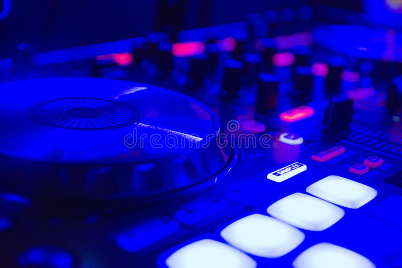 Dj mixer in the night club blue light and tones royalty free stock photos