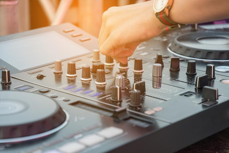 Dj mixes the track in nightclub at party. Disc equipment jockey music turntable entertainment disco audio nightlife stereo dance mixing light male mixer volume stock image