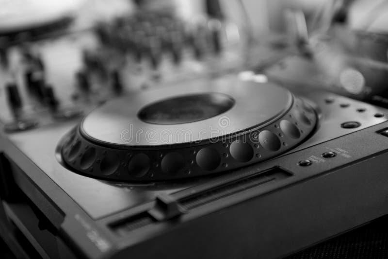 Dj mixes the track in the nightclub stock photos