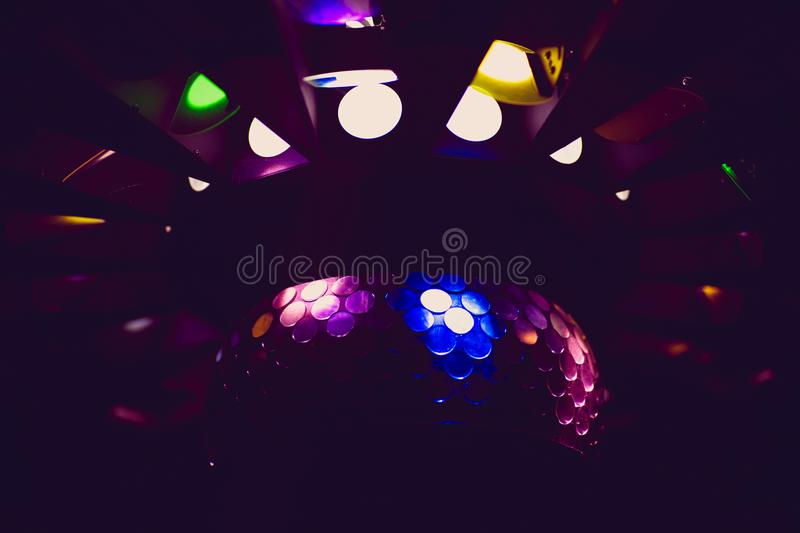 Dj mixes the track in the nightclub at party. DJ hands in motion royalty free stock image