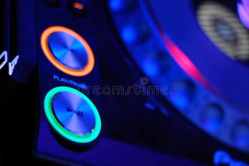Dj mixes the track in the nightclub stock photo