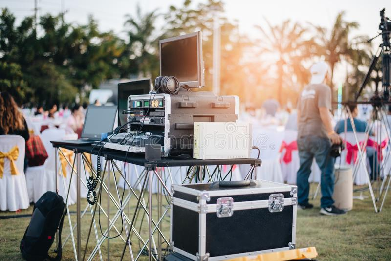 Dj mixing equalizer at outdoor in music party festival with party dinner table. Entertainment and Event organizer concept. Concert. And Musical theme royalty free stock image