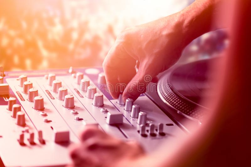 Dj mixing and playing music in nightclub royalty free stock photo