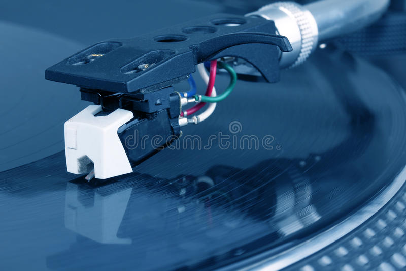Dj needle on spinning turntable royalty free stock photo