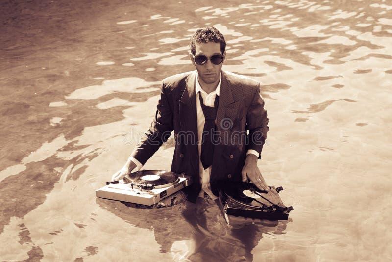 DJ in overzees stock afbeelding