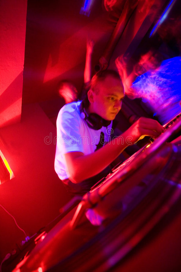 Dj at the party, motion blur. Focus on turntable stock photo