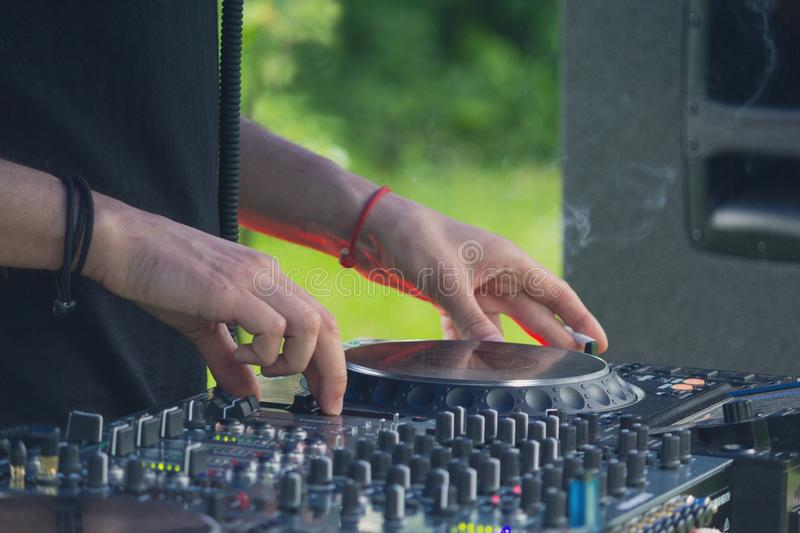 Dj playing disco house progressive electro music at the concert. DJ hands on equipment stock photo