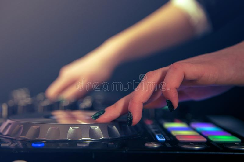 Dj playing and mixing music on turntable controller. stock images