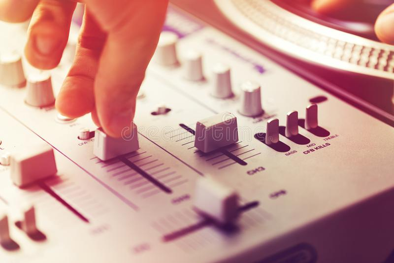 Dj playing and mixing music on turntable controller royalty free stock images