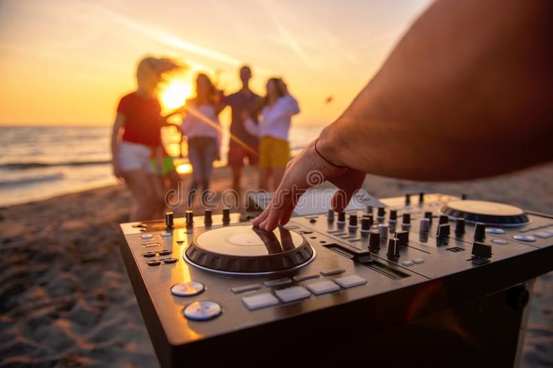 Dj playing music at a beach party royalty free stock photography