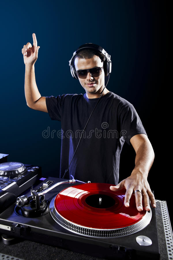 DJ playing music. Dj playing disco electro music in a concert royalty free stock images