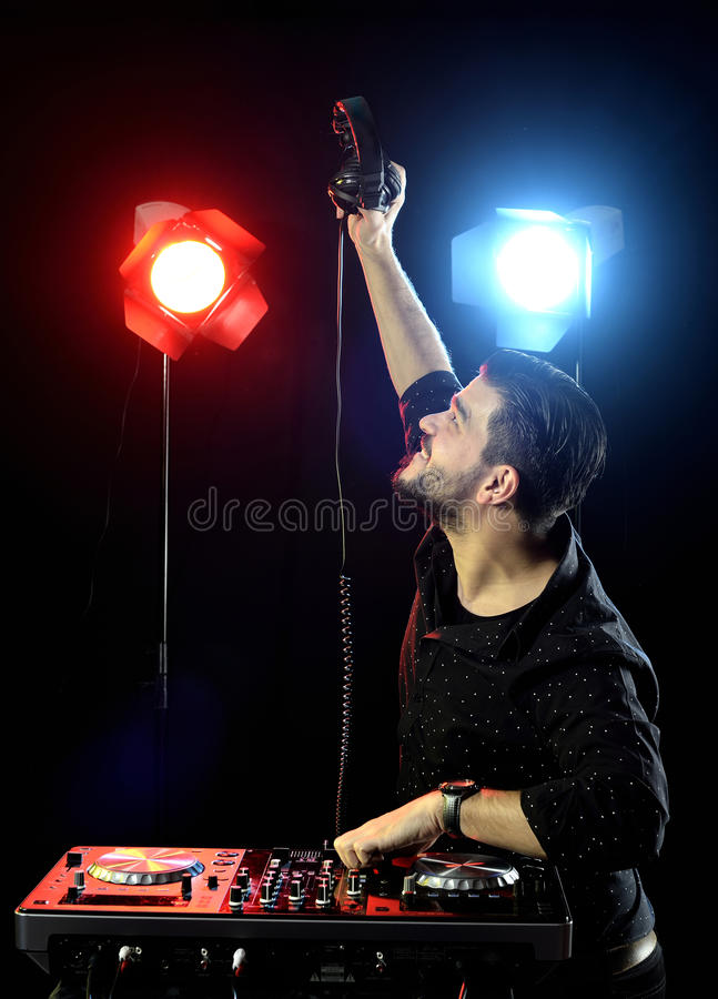 DJ playing music. Dj playing disco electro music in a concert. young man looking up royalty free stock photography