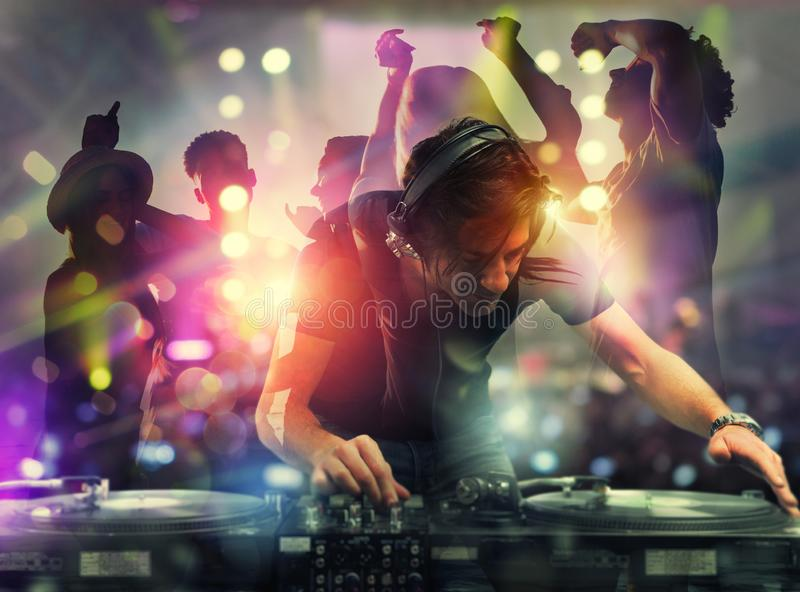 DJ playing music at the discotheque. Double exposure stock image