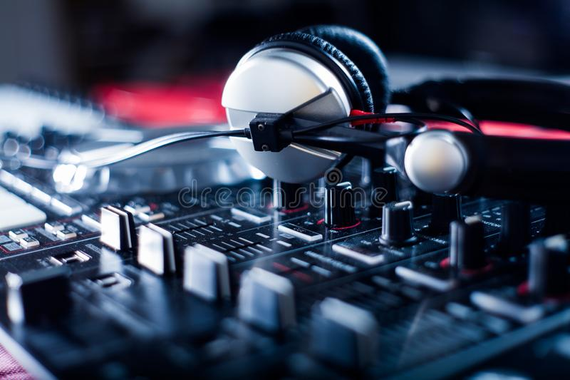DJ playing music at mixer closeup and mixes the track in the nightclub stock photo