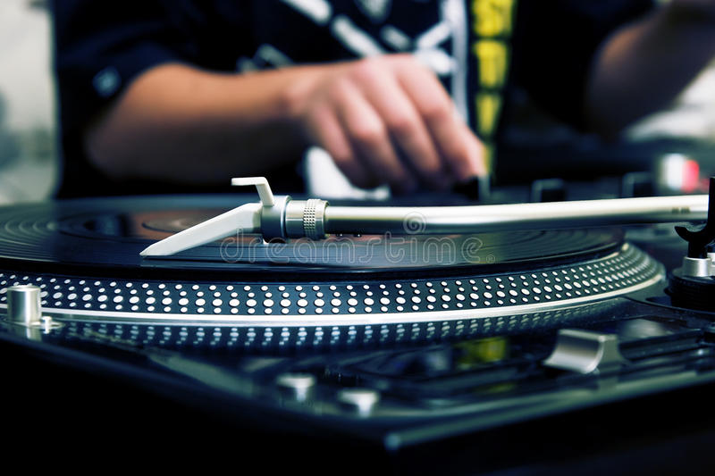Download DJ Playing Music From Vinyl Record Royalty Free Stock Photos - Image: 16570448