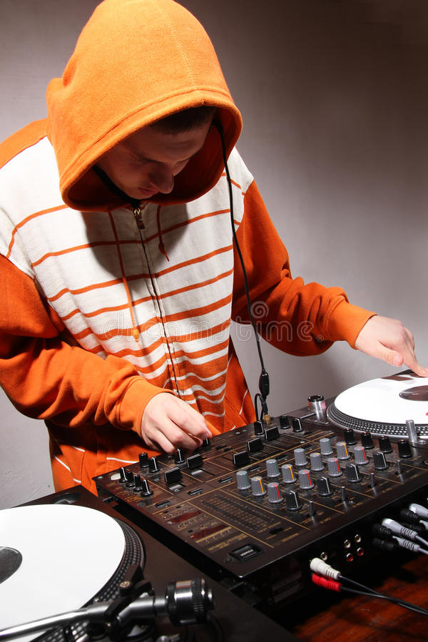DJ playing music on vinyl turntables. Disc jockey playing hip-hop music on professional top-class club equipmant stock photo