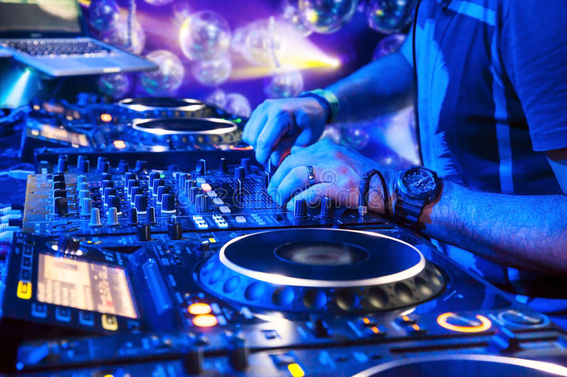 Dj playing the track. Dj mixes the track in the nightclub at party stock photo