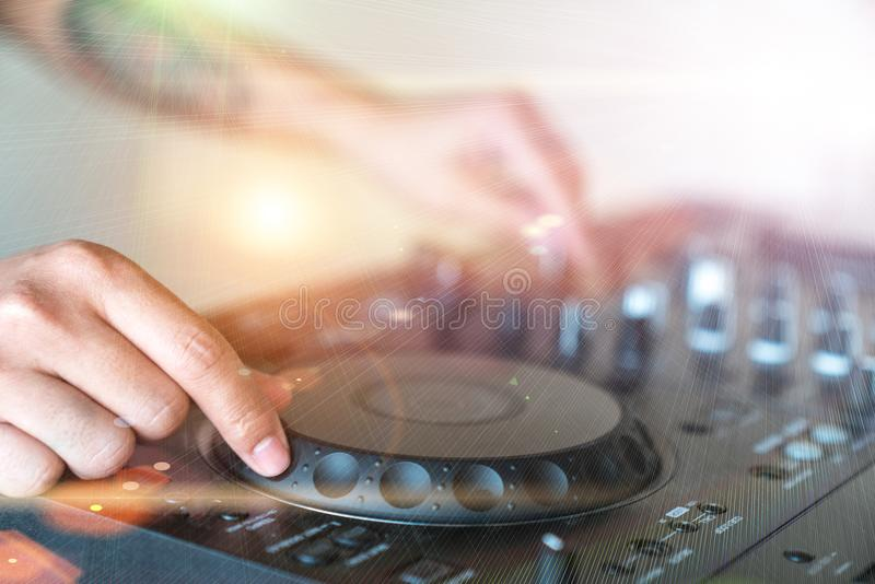 DJ plays on the best, famous CD players at nightclub during part royalty free stock photography