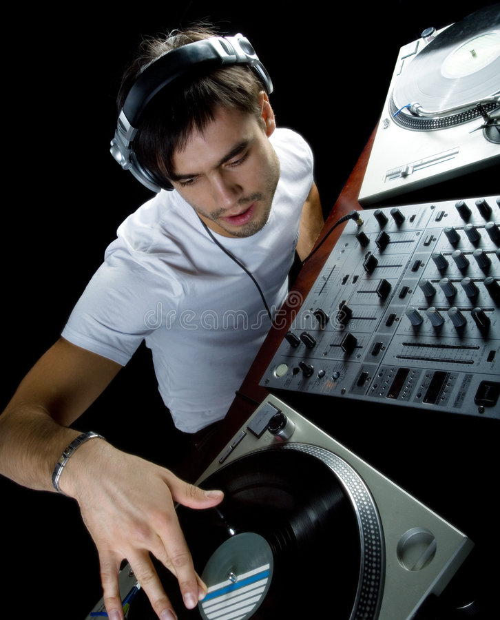 DJ plays set i. N a vinyl player stock photos